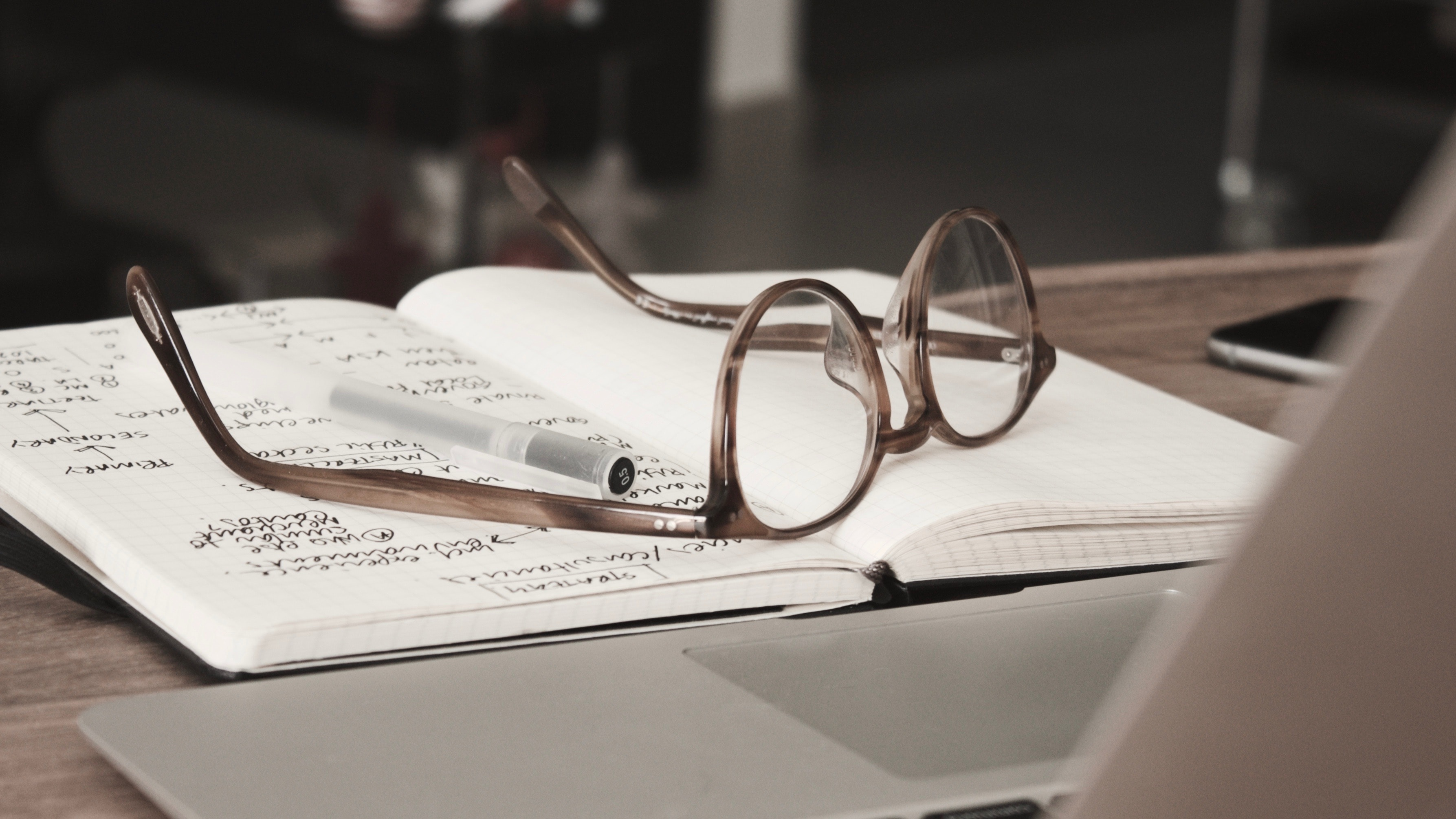 Glasses notebook and laptop